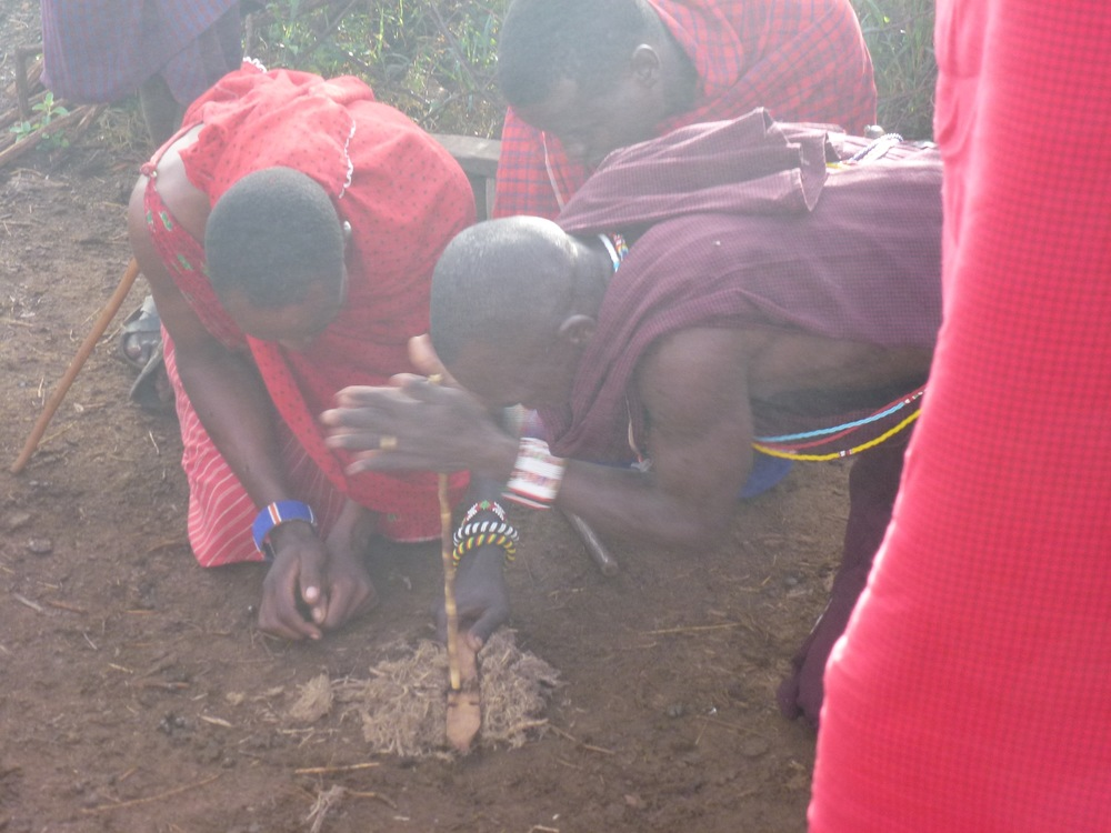 A couple of Maasai attempt to show us how they build fires when out in the wilderness without the aid of a Bic lighter. After much sheepish giggling, they call in the expert fire builder to manages to get things going.