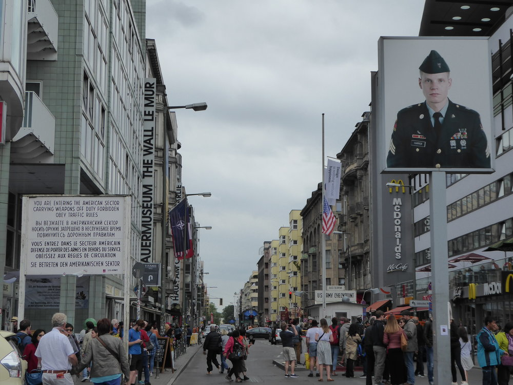 Checkpoint Charlie, now a crowded tourist mecca with a carnival-like atmosphere.
