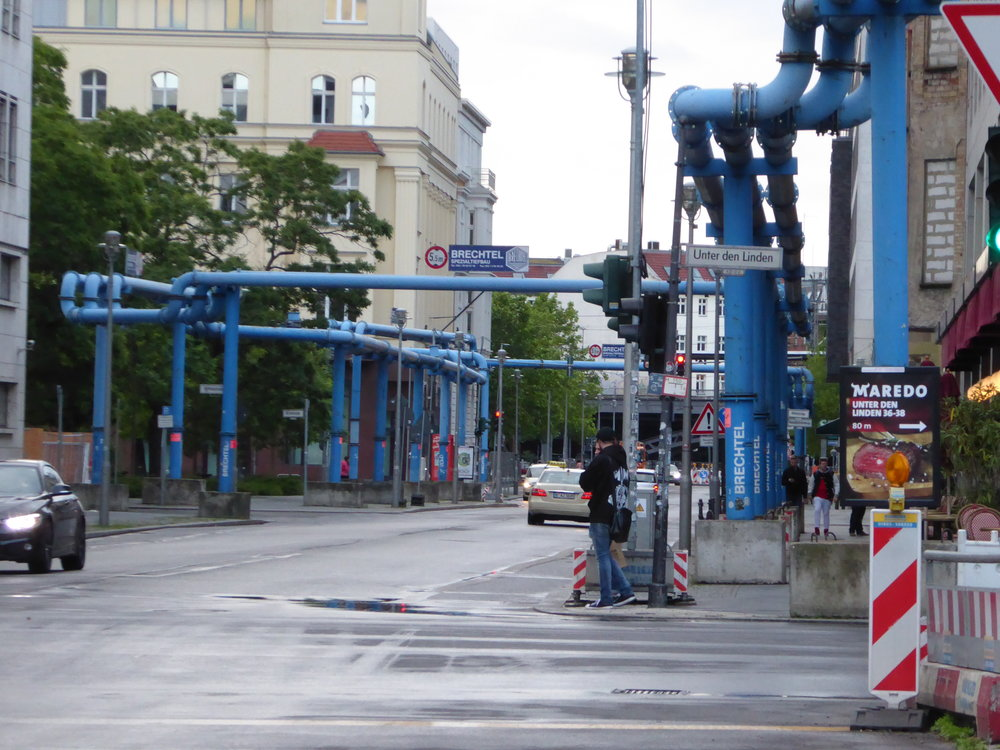 Built over a marsh, whenever there is major construction in Berlin, as in the case of a new U-bahn line, the high water table necessitates the pumping away of water, hence these blue pipes running along the street.