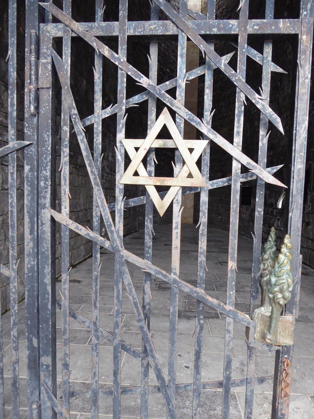 Gate of the Jewish memorial at Dachau.
