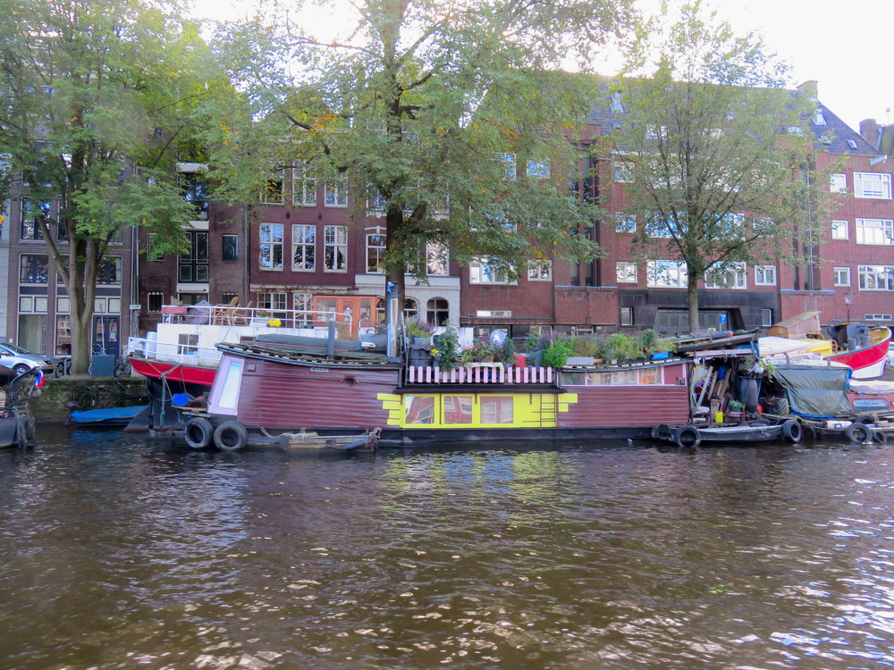 Many of the canals are lined with houseboats.