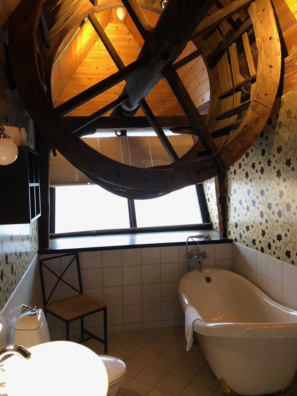 We stay one night at a  hotel  in the German Hanseatic district of Bergen, rebuilt in the early 1700s after a fire destroyed the original buildings. Above the bathtub is all that remains of an old hoist once used to pull cargo up to the storage rooms in the attic of this building.