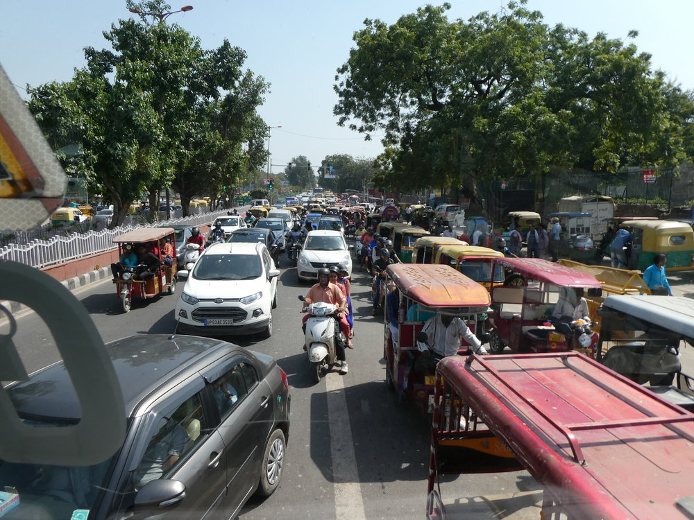 This is actually light traffic and an unusually orderly street scene for India.