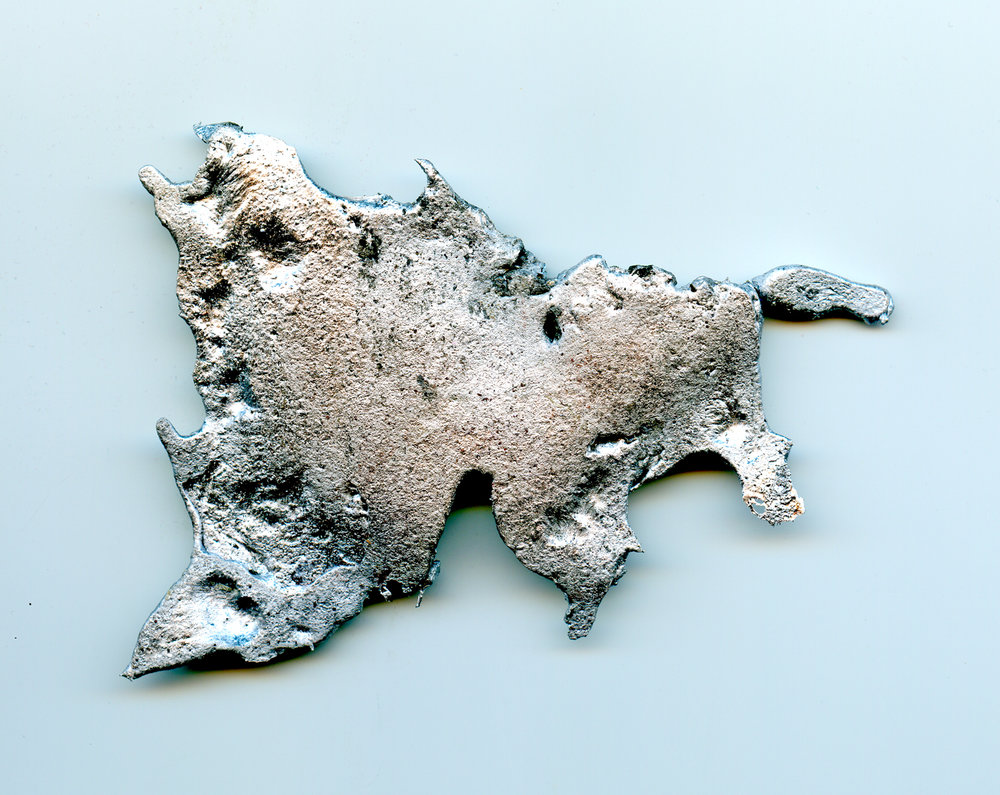 Slag created when molten aluminum is skimmed off before making the pour.