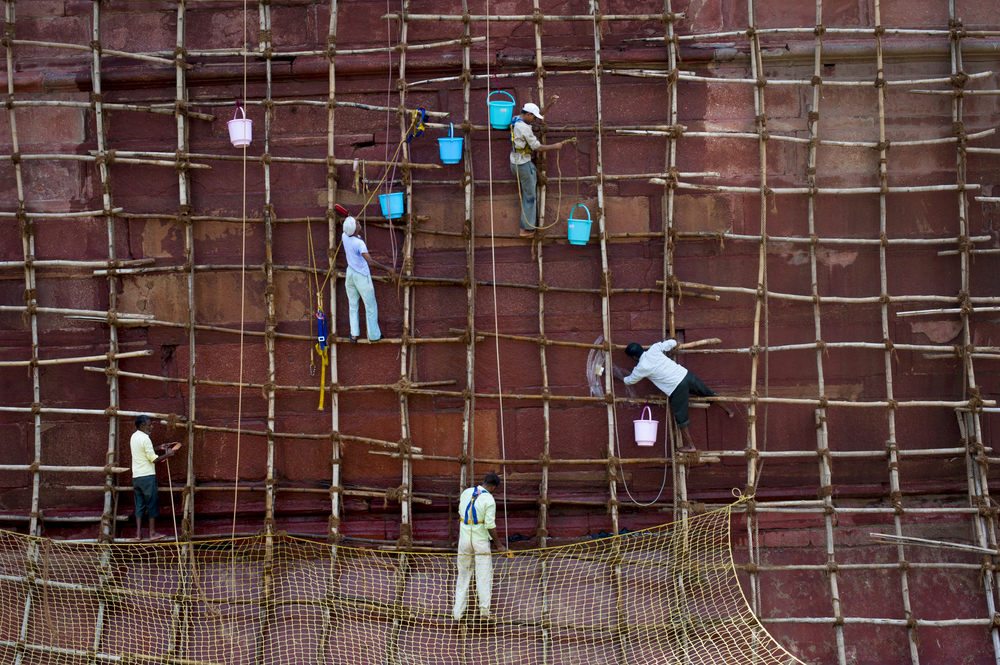 Workers clean the walls of the Red Fort, the residence of the Mughal emperor of India until 1857 and a symbol of India's independence, in Old Delhi on July 14, 2015.