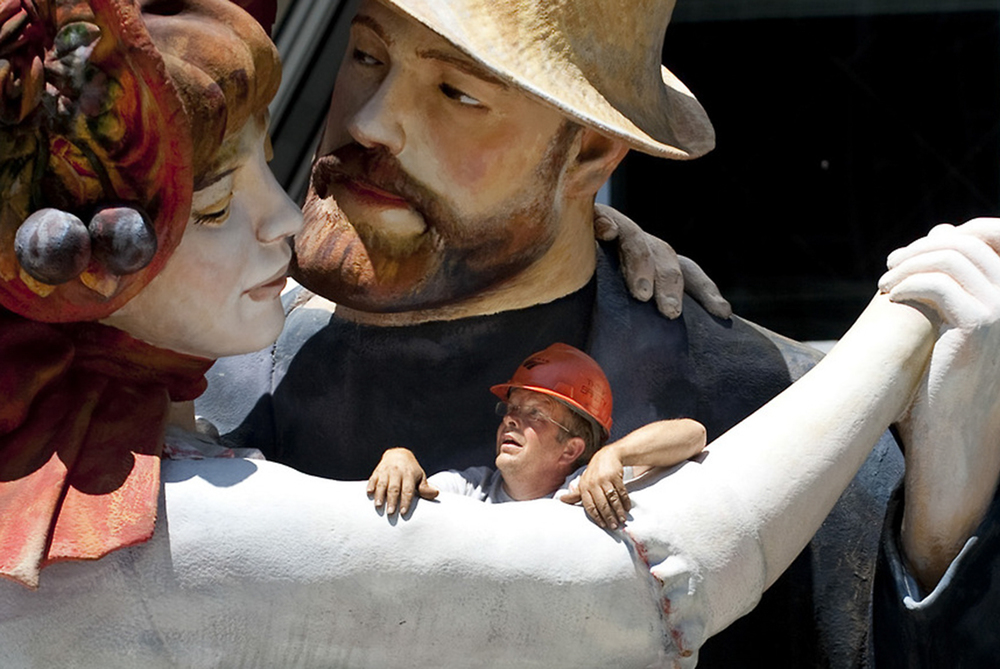 """Workers assist the final piece of the art installation """"A Turn of the Century"""" monumental sculpture of Renoir's """"A Dance at Bougival"""" at PPG Place in Pittsburgh on June 7, 2014."""