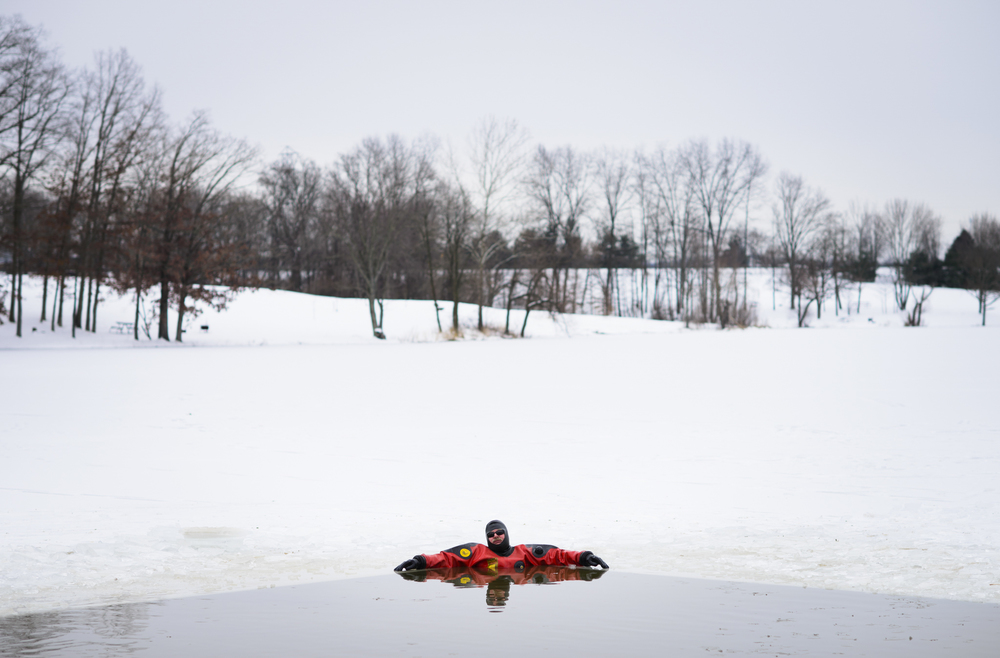 Doug Boudinot, a member of the Athens County Specialized Response and Recovery Unit, rests in the below freezing waters of Lake Snowden in Albany, Ohio in preparation for the Athens Polar Plunge, a fundraiser for the Special Olympics.
