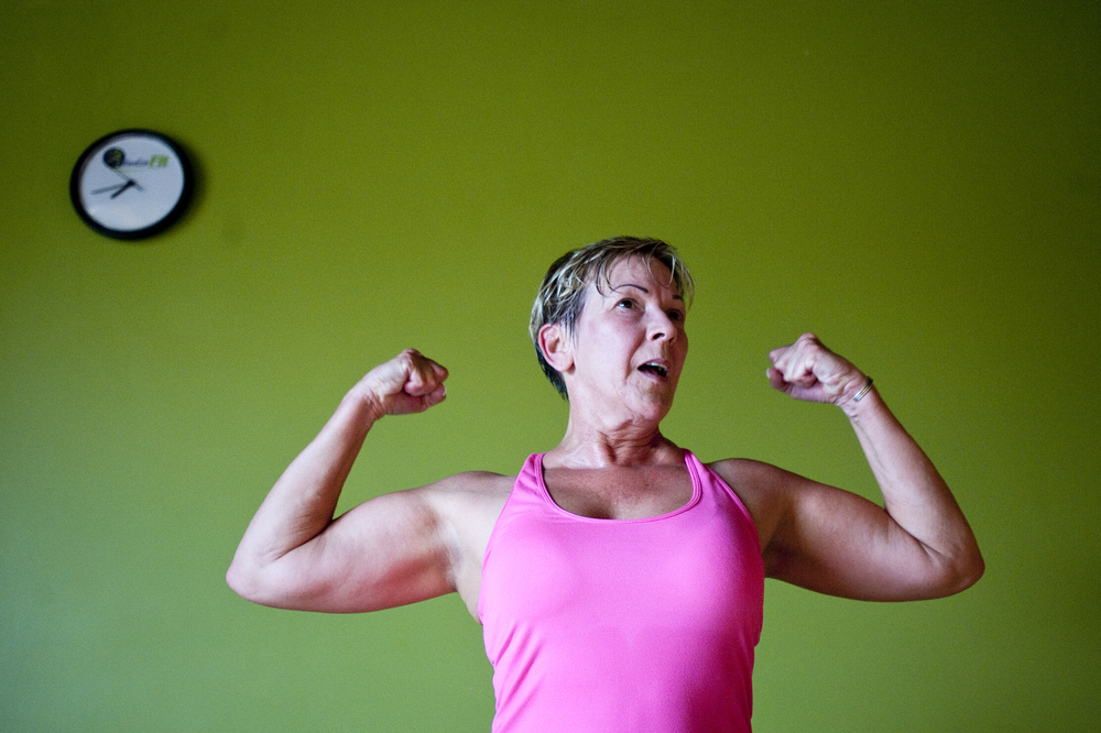 Jody Kozik, 57, of Renfrew works out her arms during her piloxing class at Studio Fit Pa on Tuesday, July 22, 2014. Piloxing, a workout consisting of pilates, dance, and boxing, is an all-in-one workout for balance, strength, and cardio, according to Verdecchia.
