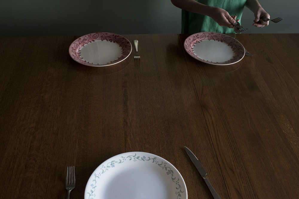 Keaton, 12, sets the table before having dinner with his brothers and sisters. Having dinner with the whole family is far and few between because of everyone's different schedules.