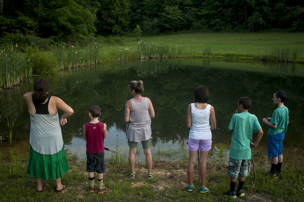 From left to right, Nina, Liam, DJ, Olivia, Sean, and Keaton Fuller pause during a hike throughout the trails on their land while the rest of the family relaxes at the house. The family spends most of their time together in their home and on their land, a place for the children to heal and grow.