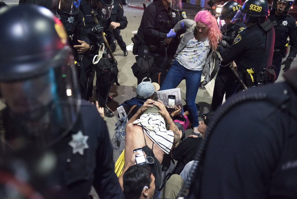 Protesters are arrested by Oakland Police Department riot police in the late hours of an anti-Trump protest that filled the streets of downtown Oakland on November 9, 2016.