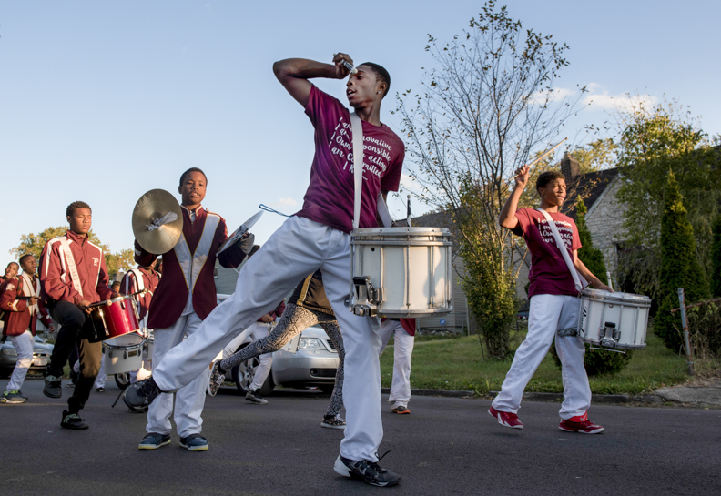 Linden-McKinley senior snare drummer Jeff Floyd, middle, dances during a cadence alongside fellow snare drummer Jayshone Garland, senior, right, during the Linden-McKinley homecoming parade on Friday, October 16, 2015. The homecoming parade has always been a celebration of the Linden community and its students.