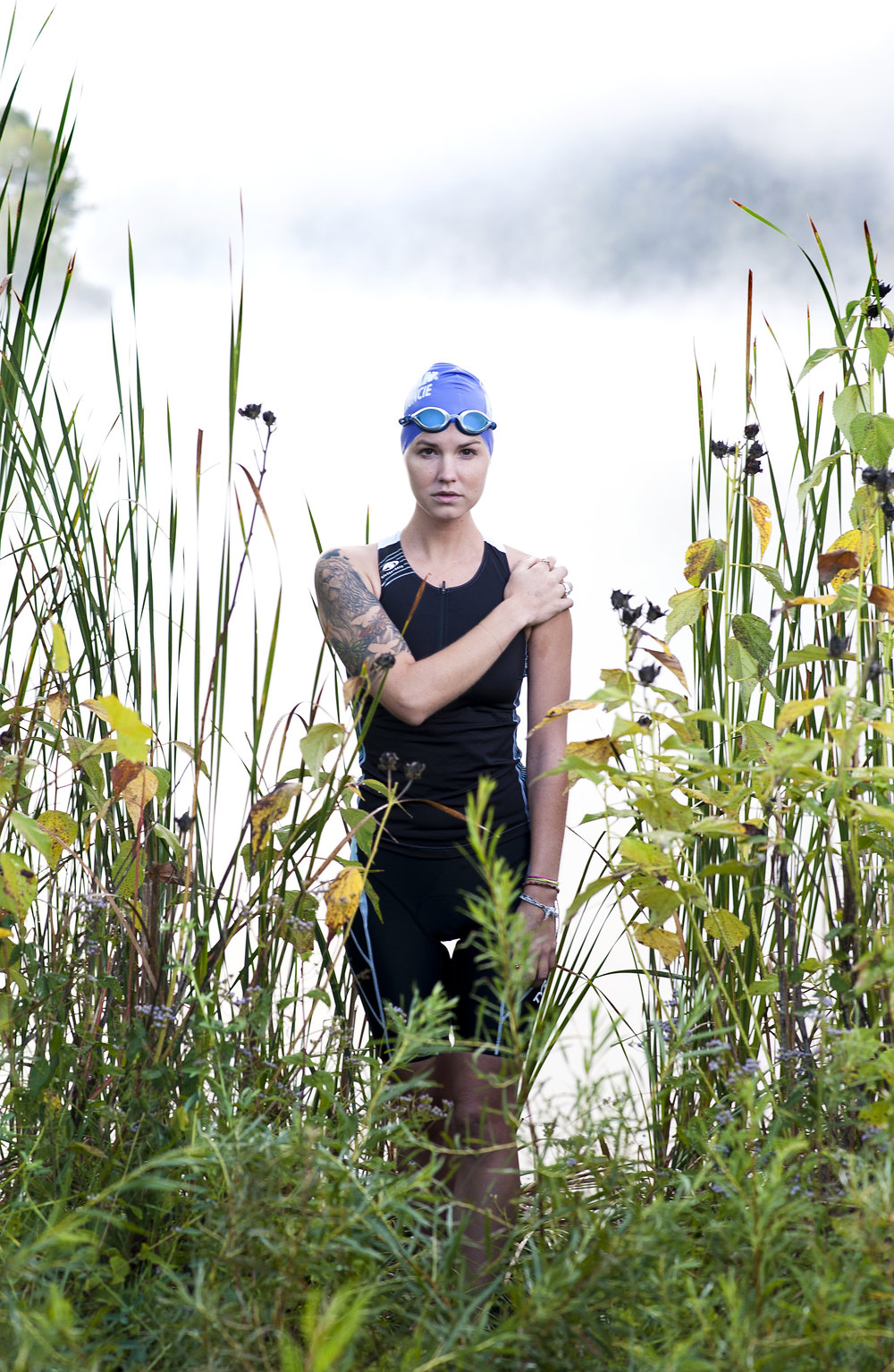 Triathlete Olivia Harlow poses for a portrait at Strouds Run State Park, where she often swims in the lake to practice.