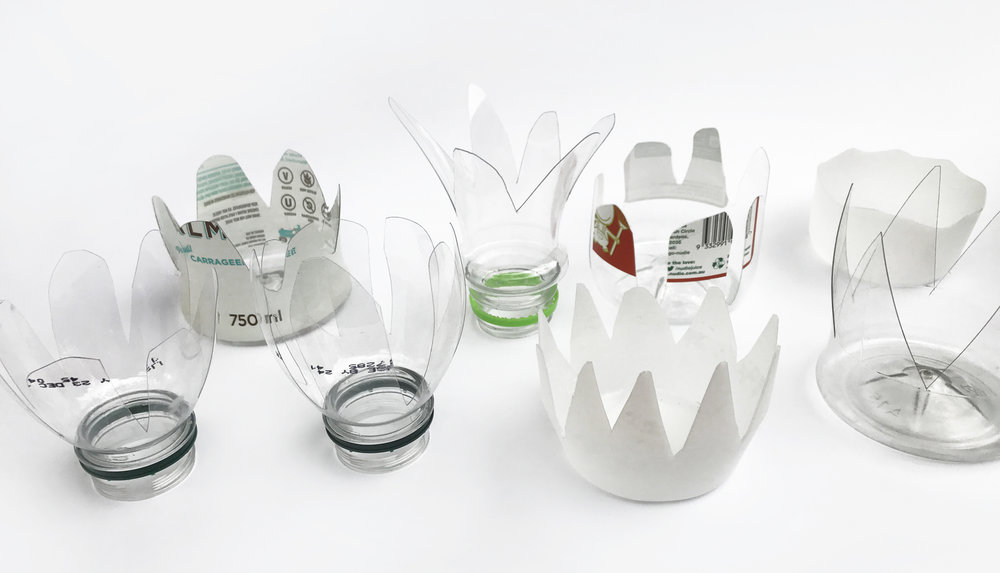 Tops and ends of bottles cut into a variety of shapes.