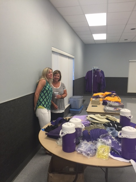 Booster Club members working the Spirit Shop at the Kick Off Dinner.