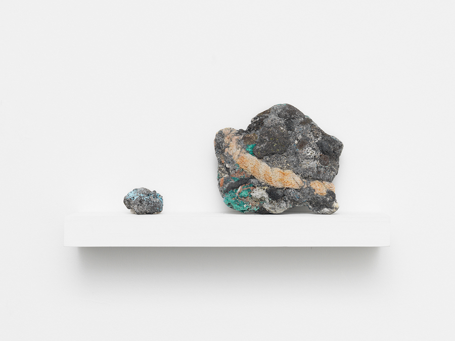 Recent Landscapes (plastiglomerate) , 2014; salvaged wood shelf and brackets, ceramic stand, and plastiglomerate samples; 8.5 x 17.75 x 4.25""