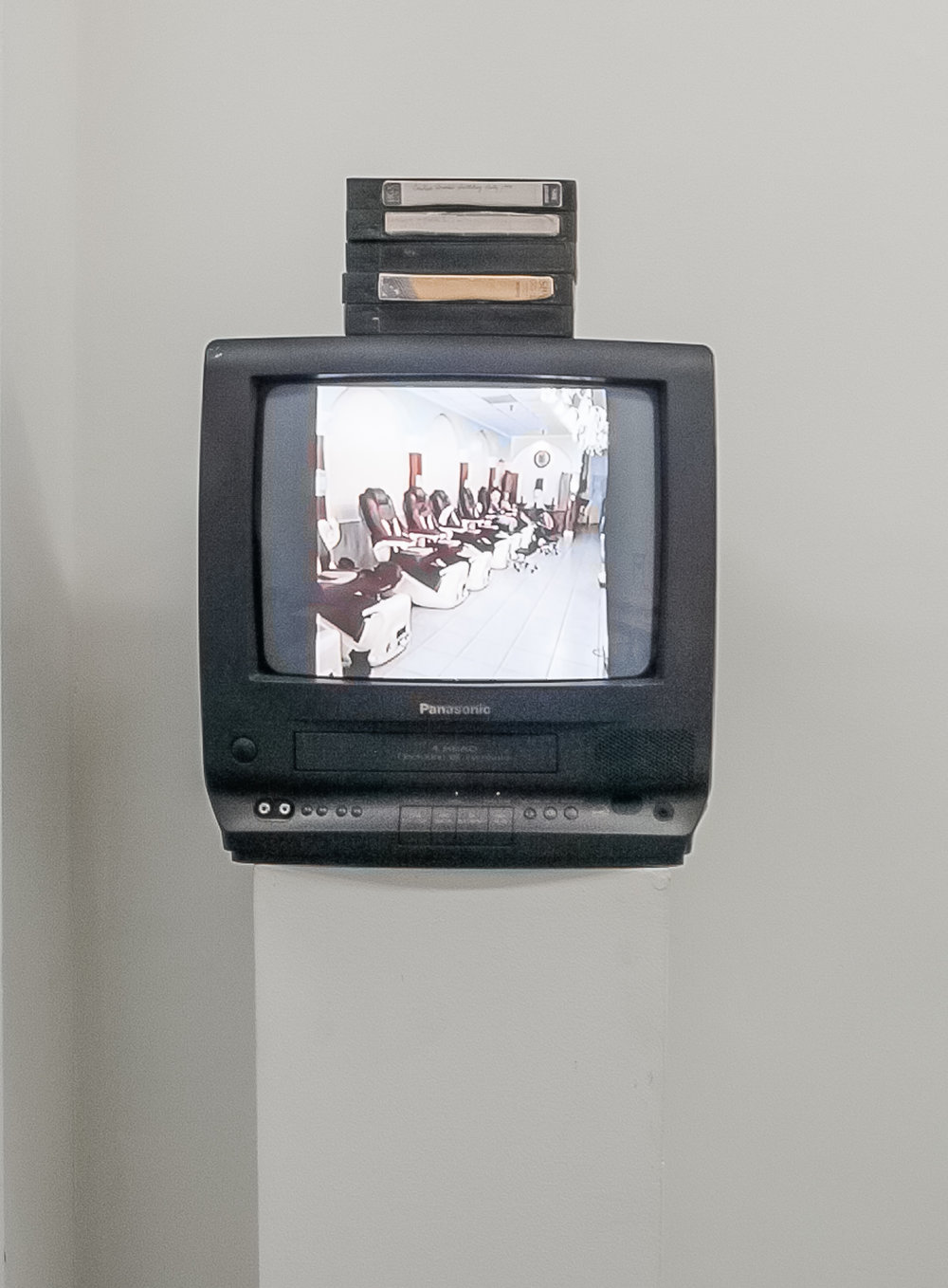 1 Families Chrismas (replica),  2017 porcelain, Panasonic TV/VCR combo, video [Sequence 02 1 (plantain mix), 19 mins 37 secs on loop], 15 x 16 x 20 inches overall