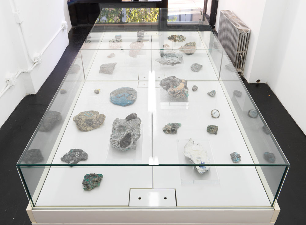 Rock Record   2017, altered found jewelry display case and store display fixtures, plastiglomerate samples, found golf ball, sand samples, found vinyl (Framed), 48 x 48 x 72""