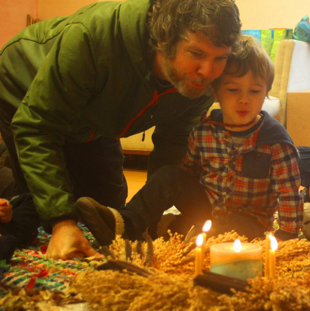 Mason and his Dad blowing out candles by Lee email.jpg