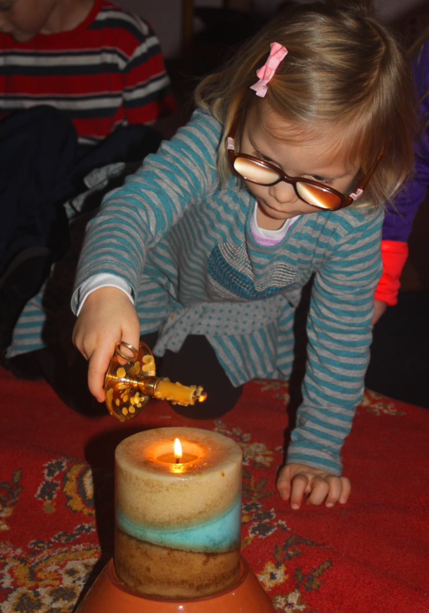 Small one with a candle email.jpg