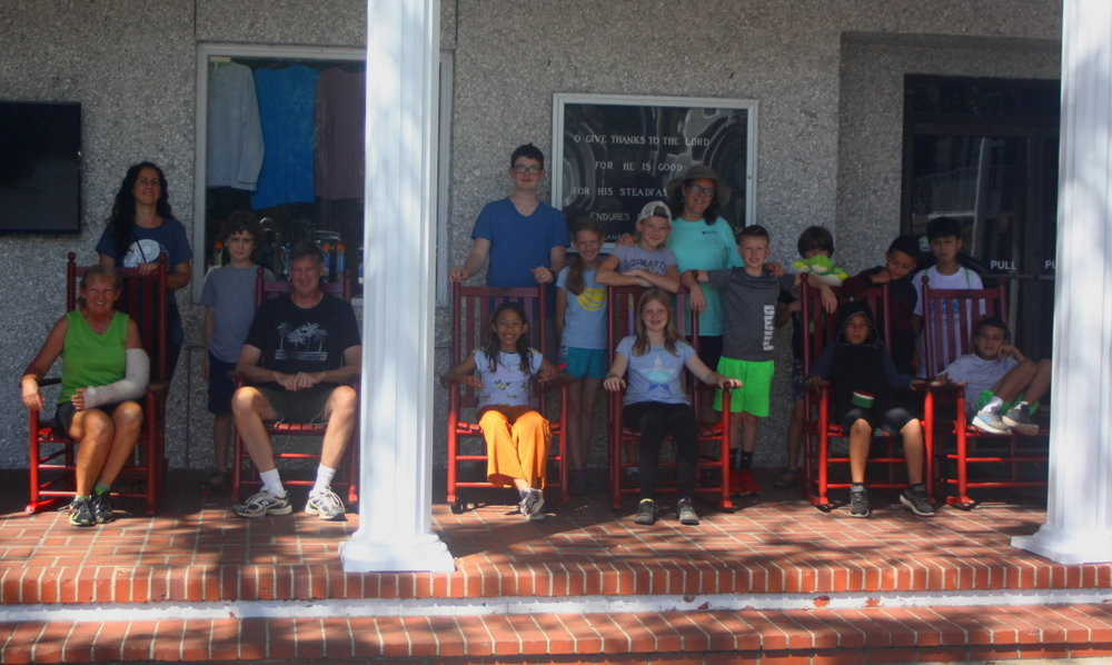 Group photo on the dining hall front porch email.jpg