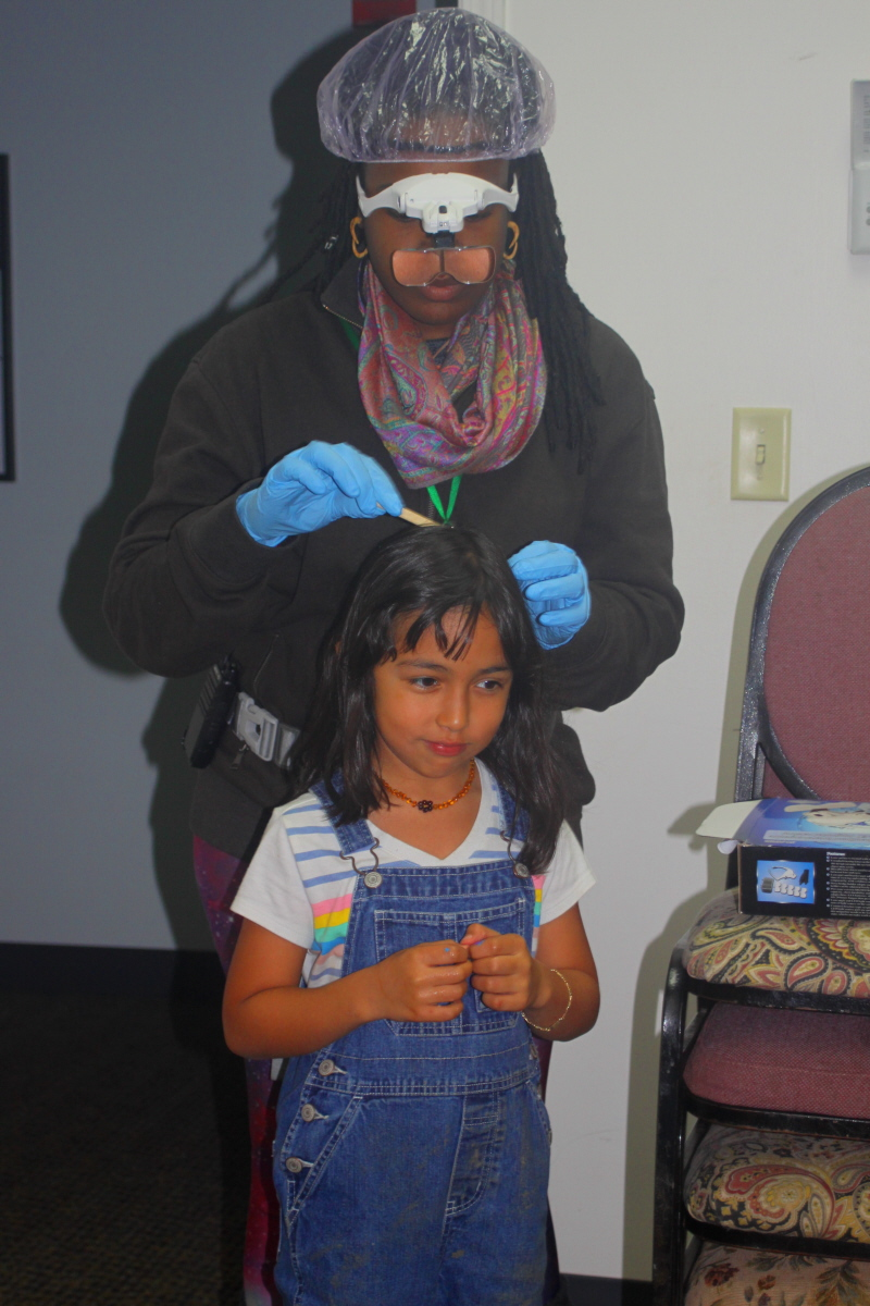 Routine head lice check by Ki Nina email.jpg
