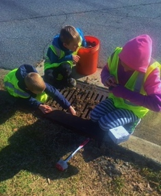 Cleaning and marking a storm drain on Ebenezer Road small.jpg