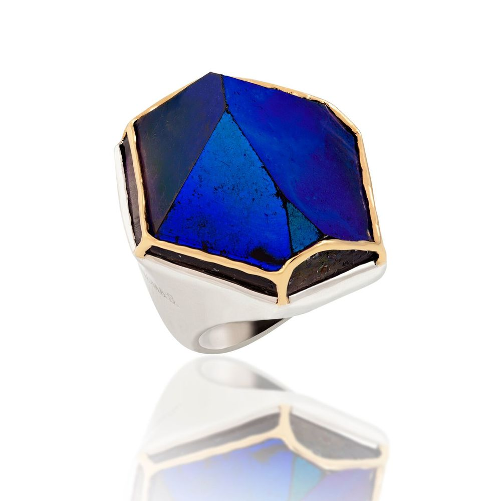 Sliced tip of a crystal, infused with titanium, with 18k yellow gold, set in white gold-plated silver ring
