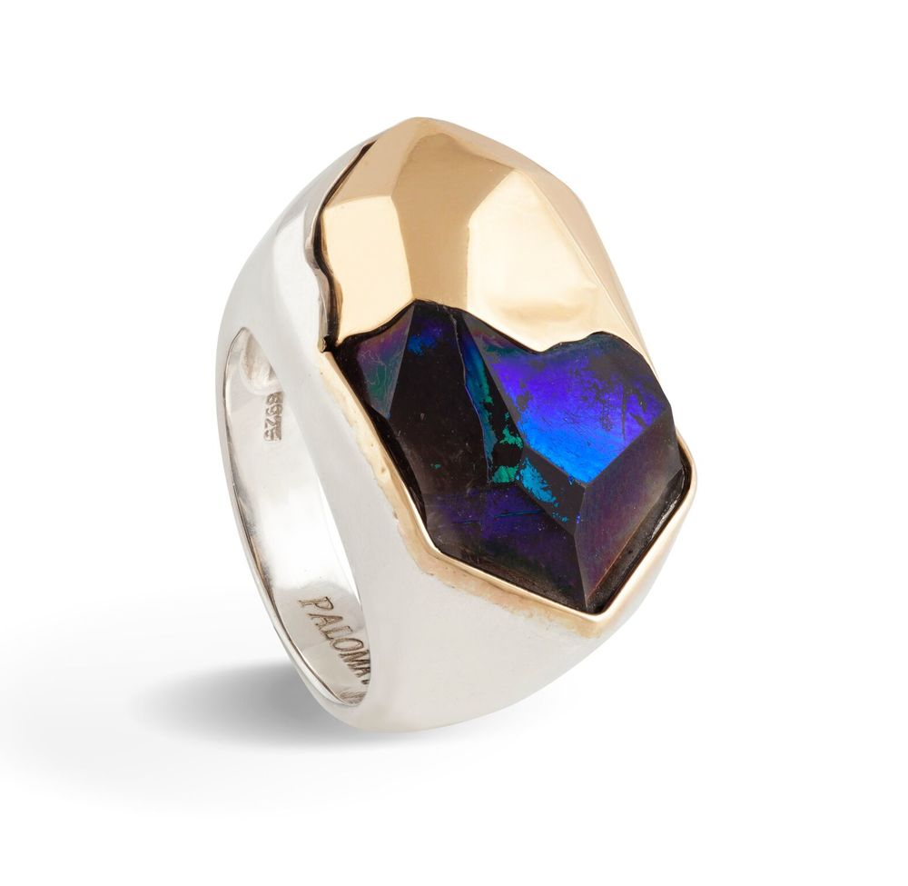 A sliced tip of a crystal, infused with titanium, with an 18k gold counterpart and an 18k gold bezel, set in white gold-plated silver ring