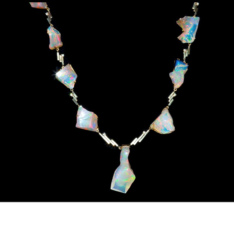 9 Wallo (Ethiopia) white opals – a total weight of 88 cts - dance around this necklace, with South African diamonds. Set in 18K gold