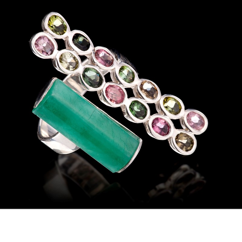 A rough emerald crystal from Colombia reaches out for double columns of pink and green tourmalines. Ring is set in 925 silver