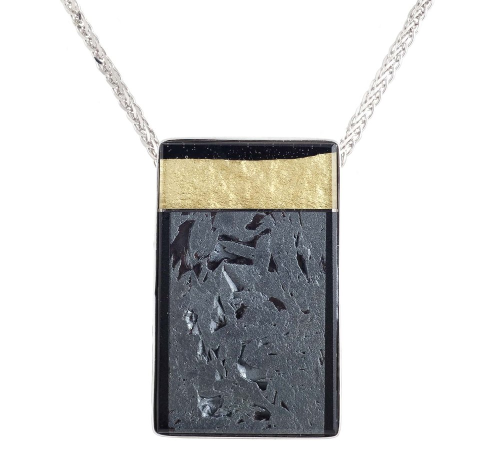 Meteorite (Russia) and 22k yellow gold covered by thin layer of rock crystal quartz pendant, with a 18k white gold bezel and mother of pearl backing
