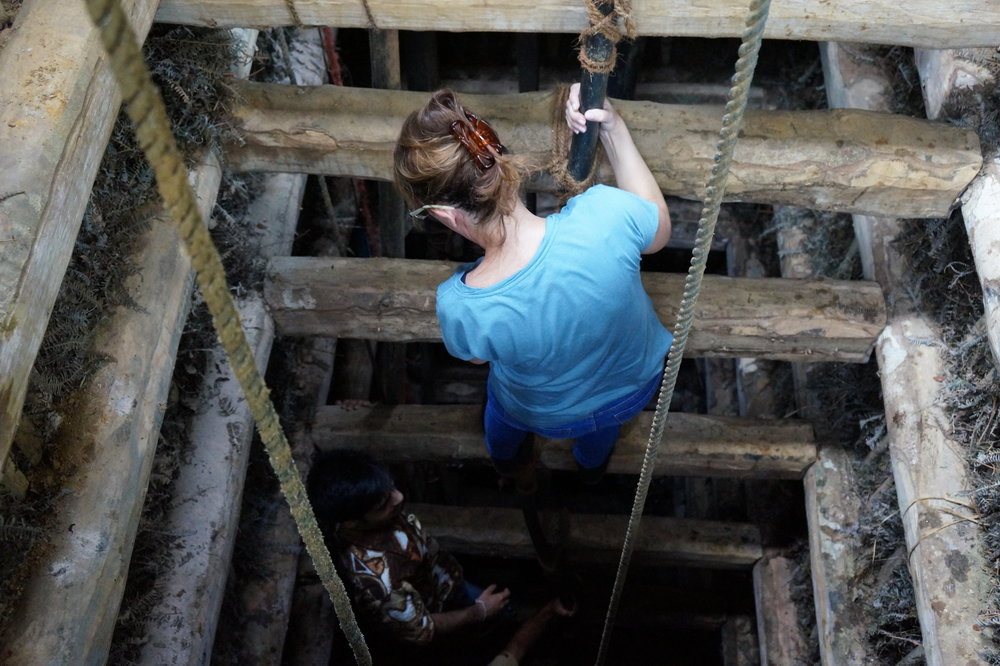 Paloma going down into a mine