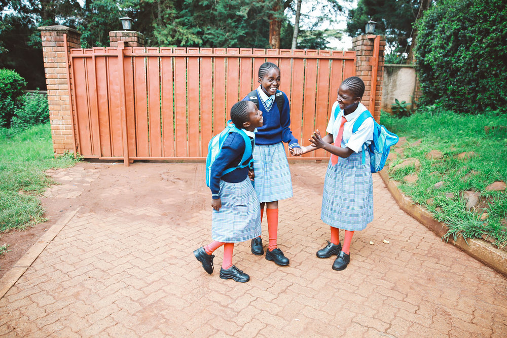 Faith, Hadija, and Marie walk home after school. The girls are members of the  ZLT  family. 30% of every purchase supports ZLT Children's Home and She Matters.