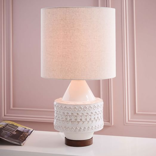 4. Not only would this beauty go well with the bedding shown in image 1, but it goes with just about any room or color palette imaginable. Perfect for a master bedroom, guest room, office or living room we just can't get enough of this pretty little table lamp.   West Elm