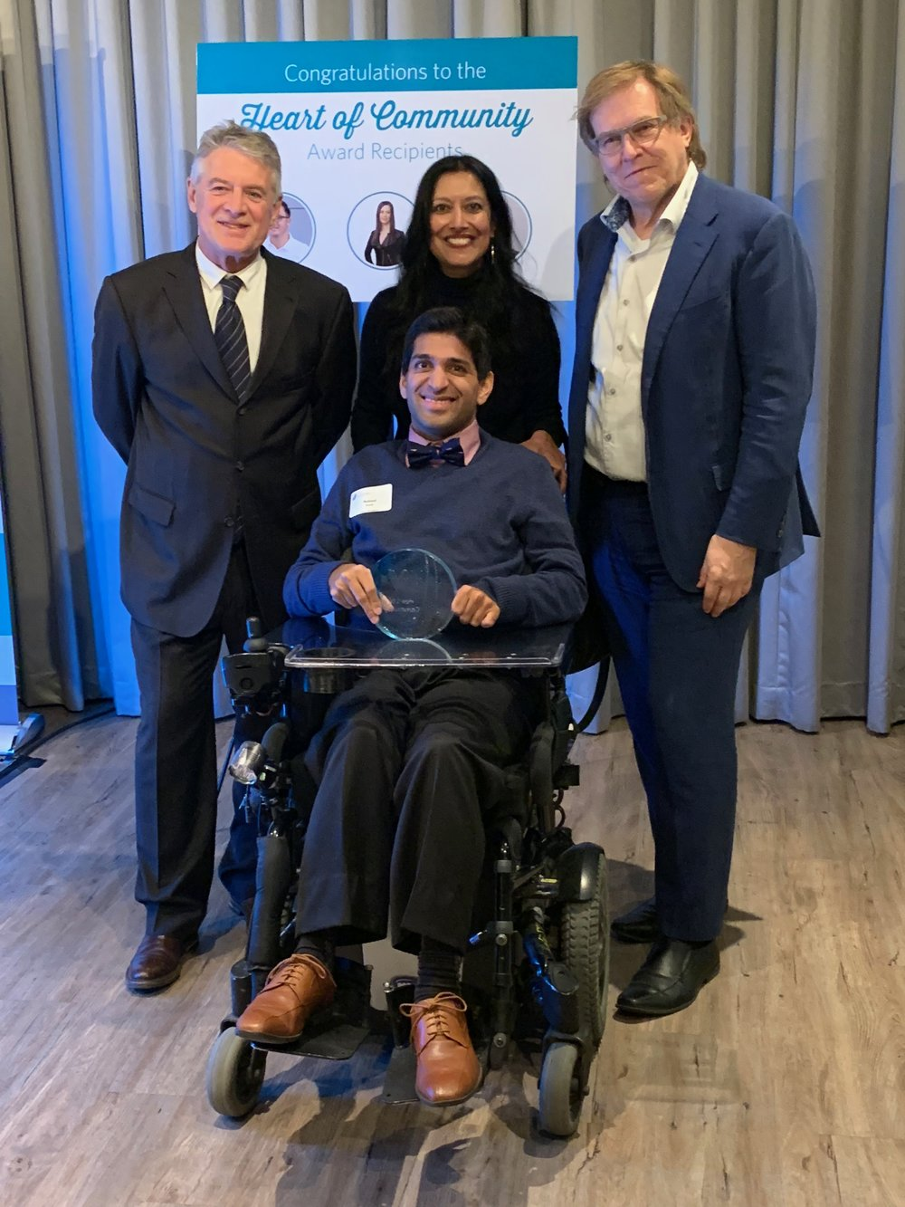 Accessible Housing's Heart of Community Award recipient, RK Access' Nabeel Ramji (front, center) along with RK Access' Erin Shilliday (back, left), Riddell Kurczaba's Niha Kroliczek (back, center) and Ron Kurczaba (back, right).