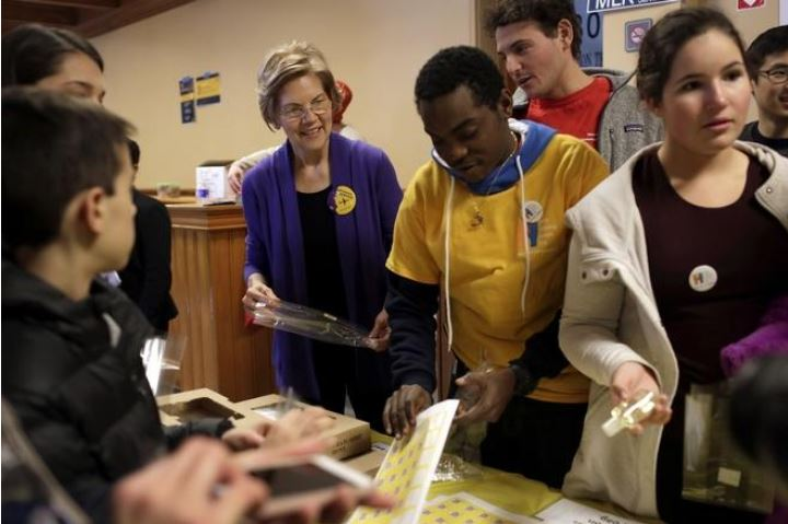 Enroot Student Harry pictured with Senator Elizabeth Warren. Picture by the  Cambridge Chronicle .