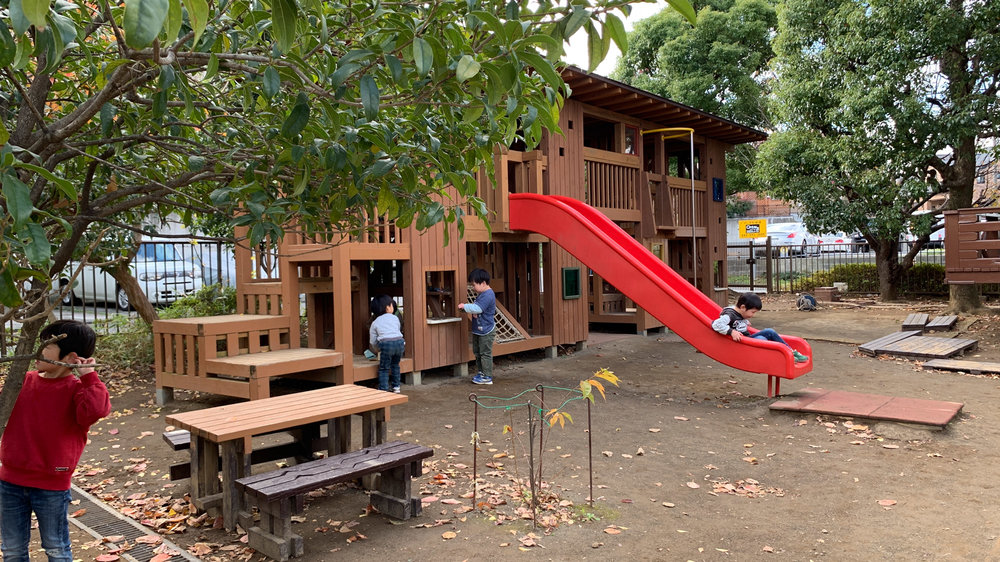 A custom-designed play environment at Kohoku Kindergarten in Japan nestled in the trees invites children to explore, climb, slide, and create their own games in and around this unique play structure.