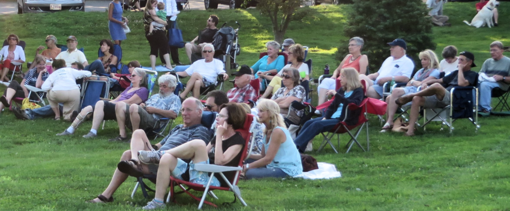 Families and friends gather to listen to Music on the Green in the summer of 2015. Photo credit John Fallender.