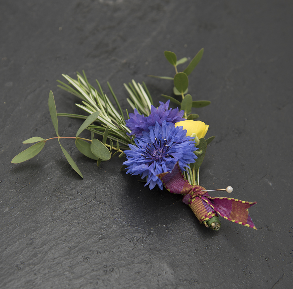 Blue and yellow groom's buttonhole