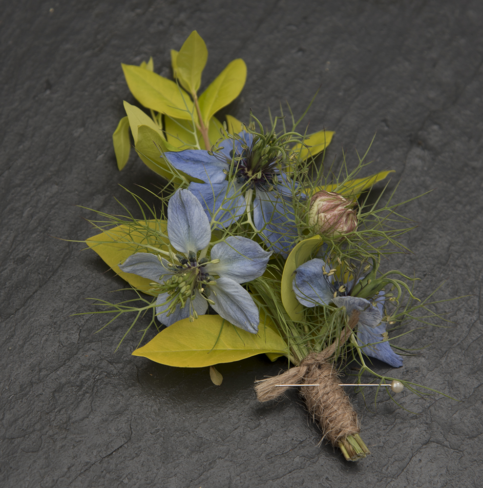 Blue flower boutonniere