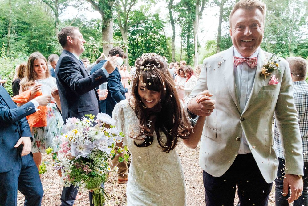 Happy bride and groom in woods.jpg
