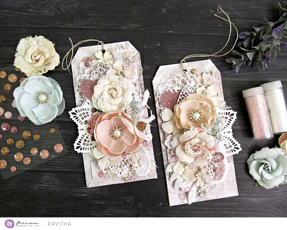 """I love the soft pink/beige/brown tones of this collection. i made a couple of layered tags using the 6*6 paper pad from Love Story. I also used the coordinating ephemera, stickers, SIIC, and flowers to embellish, then finished off with art stones and Finnabair glitters."" ~ Kavitha"