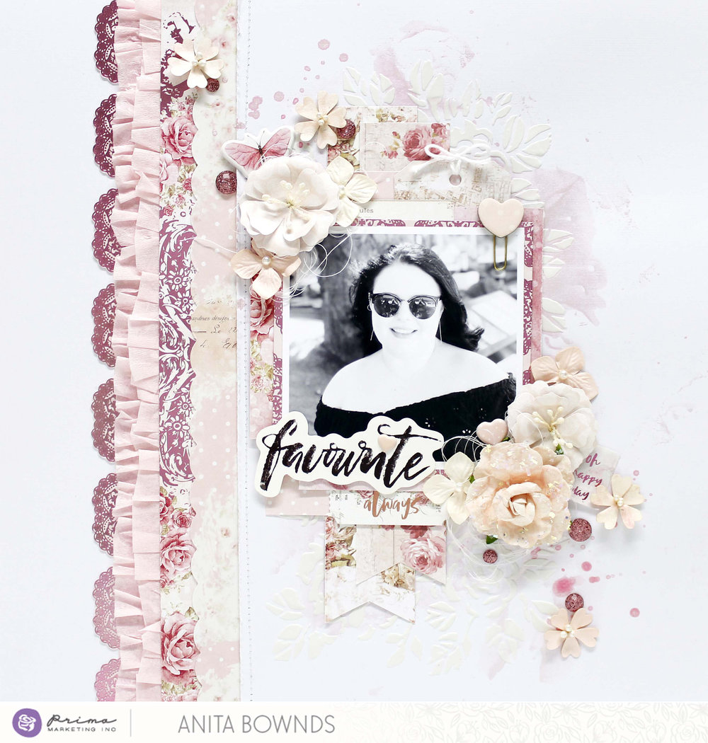 Anita's layout pulls out the lighter tones of the collection, with a splash of color here and there...showing how soft and sweet this line is! A few die-cuts and flowers frame the gorgeous photo beautifully.