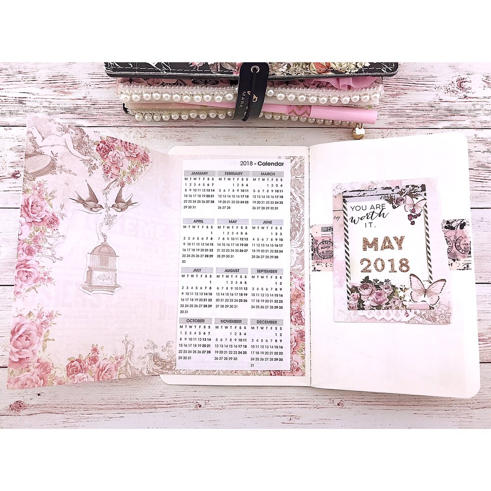 "Wendy created a folder to go inside the front cover to ""hide the necessary but unattractive calendar that I repurposed from a ring planner"" she says. This is such an easy DIY and perfect for making your journal staying looking pretty."