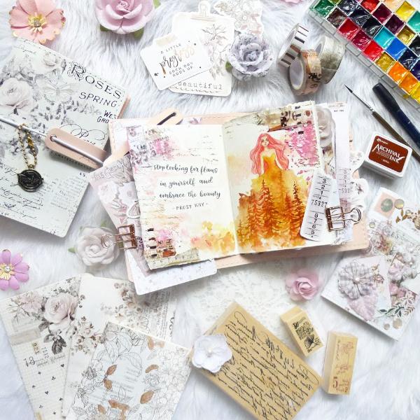 Design team member Janus creating amazing watercolor images in her journal.