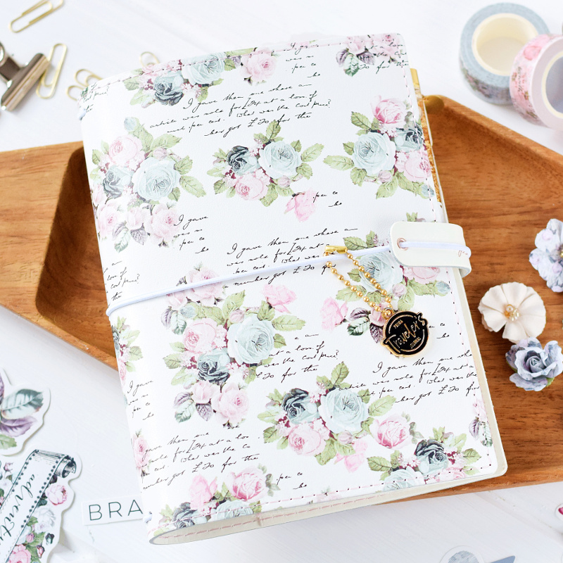Lovely spring roses detail the front cover along with beautiful scripts throughout.