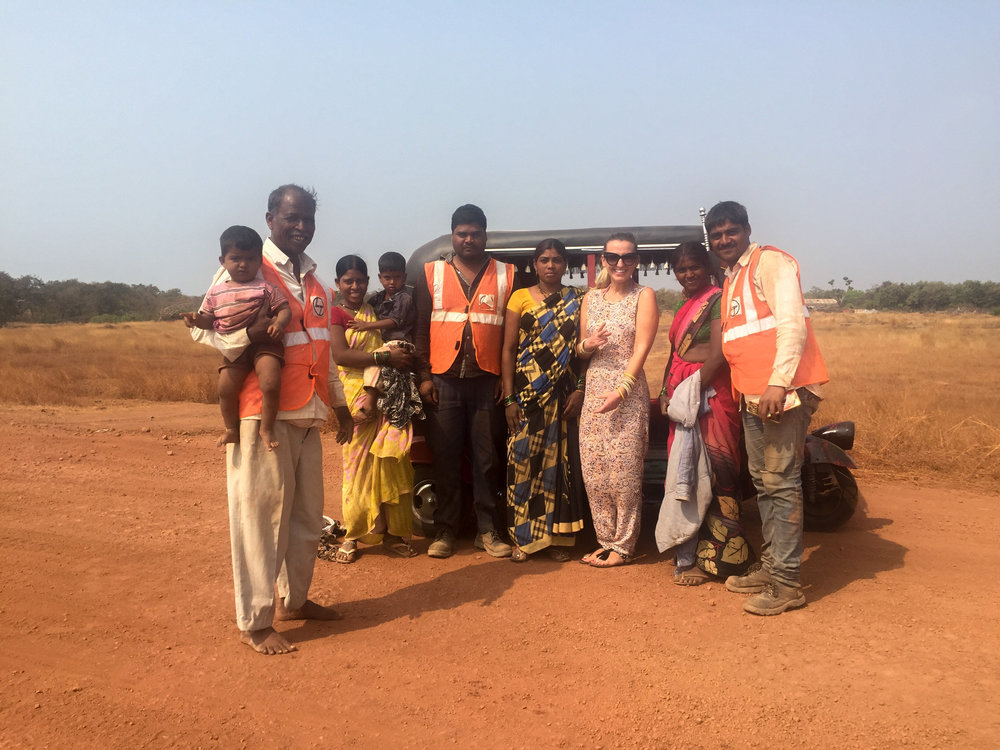 A group picture with a family excited to see us pass by near Malvan. They were working on the construction of a new airport. Did you notice anything strange about the working women in this picture? Seeing women with small babies on their backs building roads in India is a common sight. It's heartbreaking seeing a 2 year old sweeping rocks.