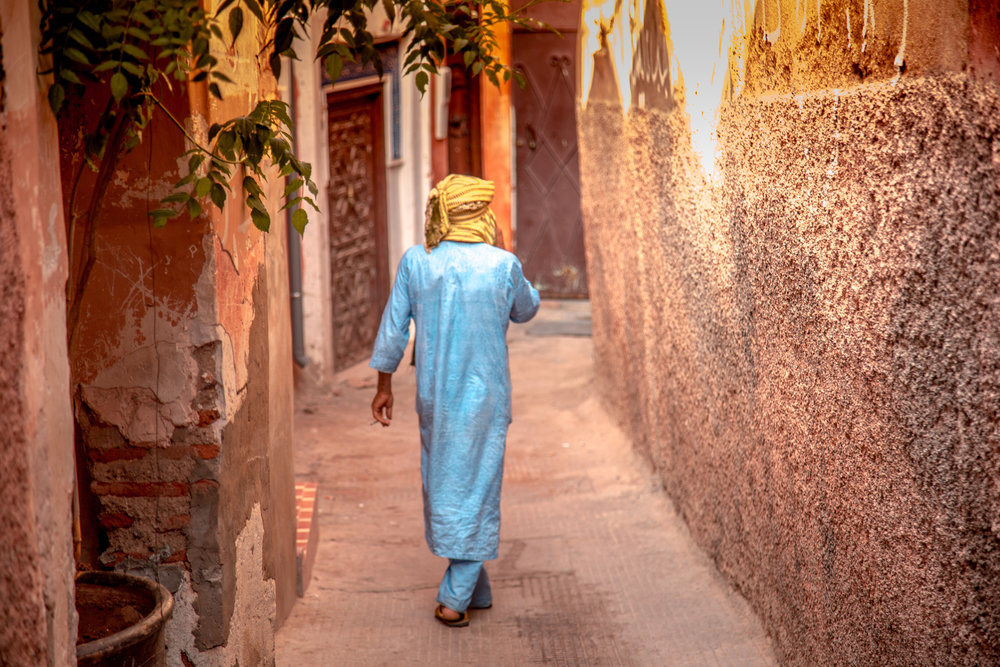 Moroccan man walking in the Medina Marrakech