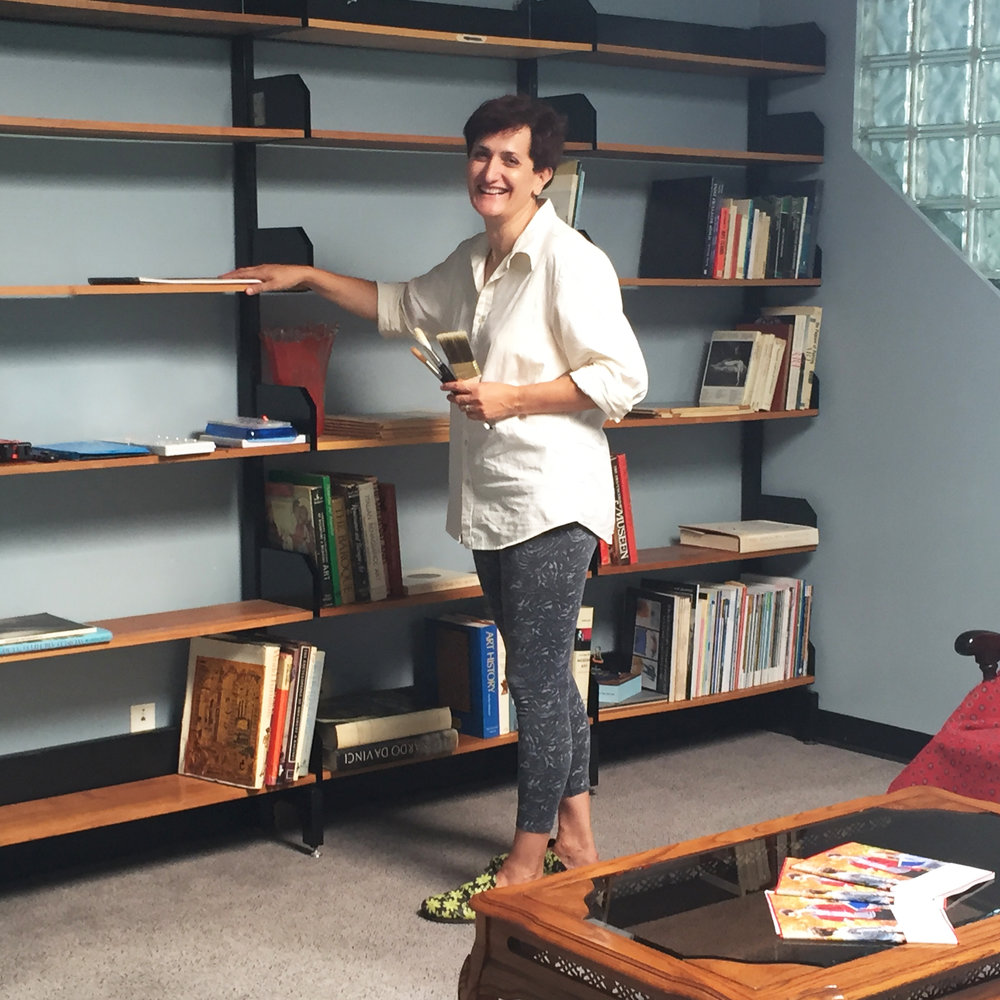 Here is me setting up our library. We're making this place feel like home!